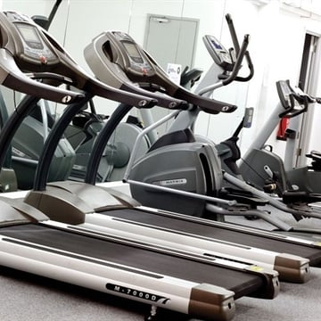 Photos of treadmills and a Cross Trainer in the Fresh Egg Gym