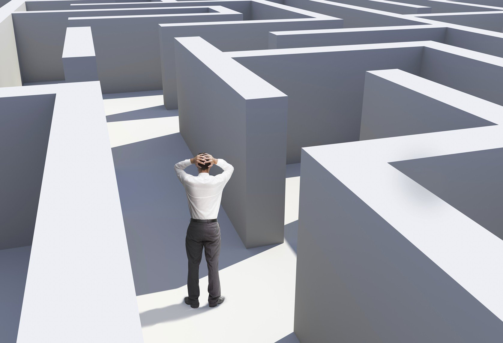 Frustrated man lost in a maze