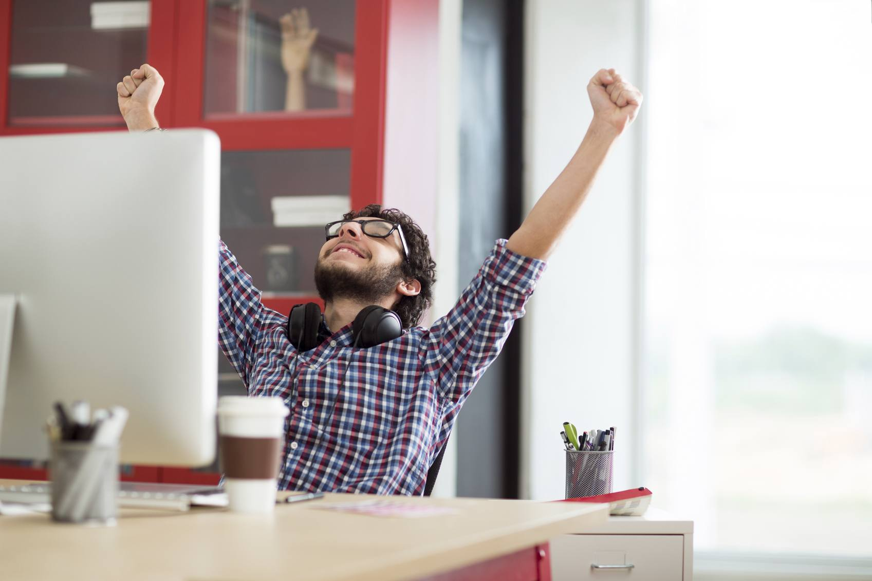 Enthusiastic worker celebrating success